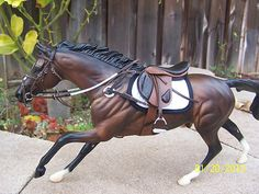That saddle is incredible! I want it! Put this horse in a cross country course and this would be an amazing scene!