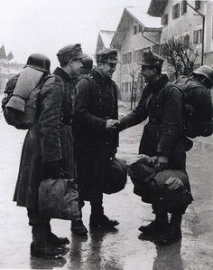 Three Gebirgsjager (mountain infantry) soldiers have just arrived at a small alpine town in the Salzburg area at the start of their Christmas leave.
