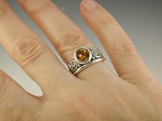 R899- Sterling Silver Ring with a 8 mm Golden Citrine, has a smooth Top and a Faceted bottom, Size 8. I can size it to fit, just contact me. No charge to size down, and no charge for one size up. The top of the ring measures 11.5 mm and the band is 2 mm. This ring is made by the