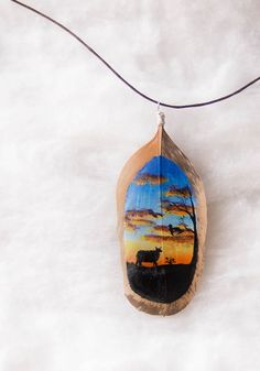 Hand painted cheep and sunset feather jewelry by hoyhenenkevytta on Etsy