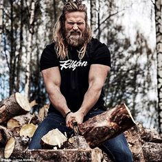 Lasse showed his butch side with a snap of him wood chopping, with the caption: 'Hit the #...