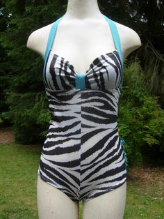 Turquoise and zebra print swimsuit