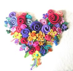LOVE felted flowers & crochet.   I must make this!