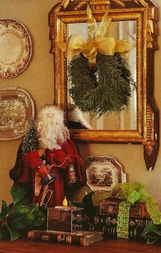 Christmas vignette with Olde World Santa: I like the stacks of books tied with ribbon.  So pretty.