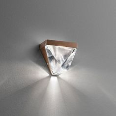 The Tripla LED Wall Sconce is composed of finest crystal, shaped into a classic pyramid. http://www.ylighting.com/fabbian-tripla-led-wall-sconce.html