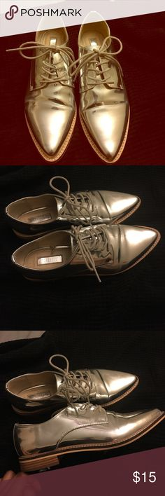 Mirror glam oxfords Pointy toe oxfords with laces. Shoes are a mirrored/silver color. Only issue is crease mark on front of both shoes as pictured. Size 8 Forever 21 Shoes