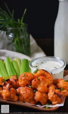 Baked Buffalo Cauliflower Bites by Life Tastes Good with a dairy-free ranch dipping sauce are loaded with all the flavors of one of our favorite Monday Night Football appetizers, but in a better-for-you option. These spicy bites are meatless and dairy f Baked Buffalo Cauliflower, Cauliflower Recipes, Clean Eating, Healthy Eating, Vegetarian Recipes, Cooking Recipes, Healthy Recipes, Vegetarian Appetizers, Salads