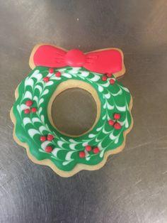 Royal icing Christmas wreath sugar cookie.