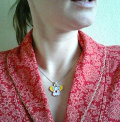 wearing the sweet singing angel as a necklace. If you want one, visit my shop! http://nl.dawanda.com/shop/atelierspunk
