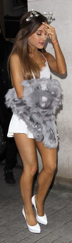 Ariana Grande wore a skimpy crop top and skirt set in London