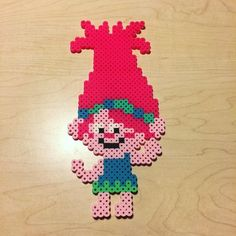 Poppy from the new Trolls movie perler bead sprite. #sleepystitchshop #trolls #poppy #perler #perlerbeads #hama #hamabeads #fusebeads #meltybeads #8bit #pixel #pixelart #sprite #handmade #homemade #geek #nerd #fandom #cartoon #animation #doll