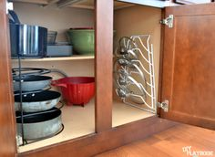 Organized pots and pans in cabinet. I really need these!!