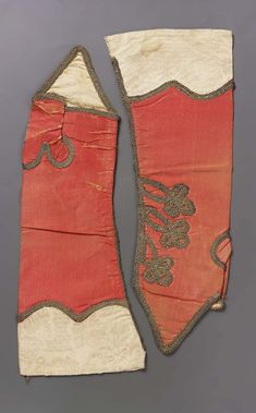 Pair of mitts, 18th century. Pinkish orange silk with cuffs of cream colored…