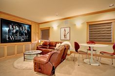 Contemporary Home Theater with Tendy stacking chairs, can lights, Carpet, Custom casework, Wall sconce, Paint, Roman shades
