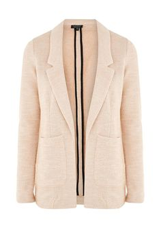 Пиджак от Topshop прямого кроя. Модель выполнена из фактурного текстиля. Детали: воротник с лацканами, два кармана, без застежки.