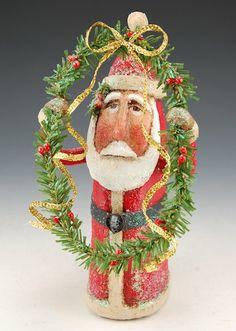 Santa Looking Through Wreath | Santa Claus Figurines and Hand Carved Wooden Santas