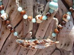 Birds of a feather beaded necklace with feather ceramic focal bead, hand made, semi precious beads by Ingelinestreasures on Etsy