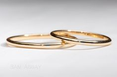 Narrow wedding rings with white gold inlay.