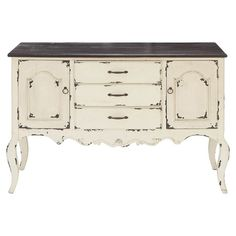 Antiqued sideboard with a scalloped apron and cabriole legs.    Product: SideboardConstruction Material: Wood...