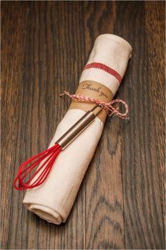 tea towel and mini whisk shower favor #bridalshower #weddingfavor #weddingchicks http://www.weddingchicks.com/2014/03/06/julia-child-inspired-bridal-shower/