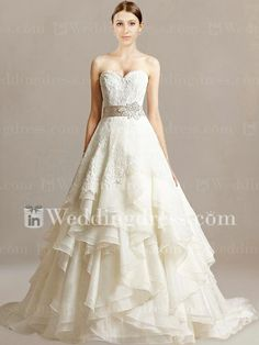 Wedding Dress with Lace. Unique poofing that doesn't look overwhelming.