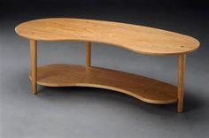 """Our Eaton Coffee table is contemporary design. This kidney shaped coffee table will dress up your living room. Shown in Cherry with Natural Oil Finish. Also available in mix and match...meaning, if you want a cherry top with walnut legs, we can do it.  Just send us an e-mail. Measures 48""""L 18""""D 16""""H"""