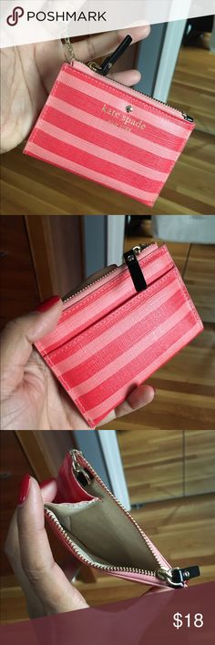 Kate spade zip card holder Striped Kate spade zip card holder with key ring. The color is more of a reddish pink orange. My nails are bright red in the last photo to show color compared to red in natural light kate spade Bags Wallets