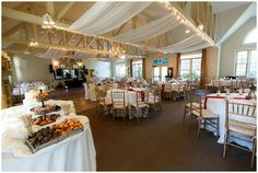 Rustic-chic reception decor with wood slabs and burgundy table runners