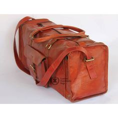 Handmade Leather Duffle Bags Stylish brown leather duffel bag made to suit all the baggage gear for all your outdoor excursions; be it work or pleasure, business trip or that swift getaway expedition, or just an overnight bag you need to stuff and go for a night-out or night-over. http://www.leatherhandmadebags.com/