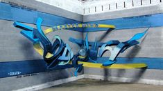 blue and yellow lettering, graffiti by odeith