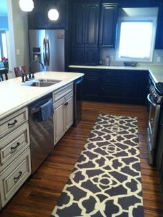 When we were building, I could hardly find pictures of kitchens with black cabinets on the perimeter and light on the island. Black distressed cabinets. Cream with dark glaze island. Kitchen. Bamboo scrapped floor. Bar stool DIY redo java gel stain.