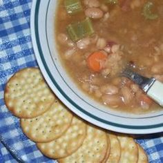 Bean Soup Recipe - This dried navy bean soup is made with a ham bone, cubed ham, carrots, onion, celery and bay leaves. Navy Bean Soup, 15 Bean Soup, Ham And Bean Soup, Bean Soup Recipes, Ham Soup, White Bean Soup, Bacon Soup, Fun Cooking, Cooking Recipes