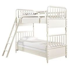 "Crafted of wood, this charming bunk bed features turned details and a French white finish. Set it in your guest room, or let it bring a sophisticated touch to your child's bedroom.  Product: Bunk bedConstruction Material: WoodColor: French whiteFeatures:  Clock shelf for upper bunk Metal pegs attach upper bunk to lower bunk Bunk bed can break down two twin beds  Bunk bed ladder steps curved and grooved for better traction Dimensions: 79"" H x 41"" W x 76"" D"