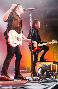 Patrick and Pete on stage.Pat is wearing his little noble shoes.OMG that's so hot too me.And then,Pete is wearing that awesome outfit,which makes him even hotter.They're like the prefect guys ever.Espically cause they're besties.