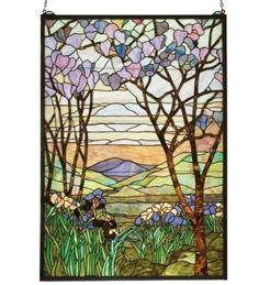 "Magnolia & Iris Landscape Window Panel. Meyda's interpretation of Louis Comfort Tiffany's Magnolia and Iris Window is made using hand cut glass individually wrapped in copperfoil. A Beautiful selection of 980 pieces of Stained Art Glass in neutral tones of Earth Browns, Verdant Greens, and Majestic Purples were hand selected to create this Masterpiece.  A solid brass hanging chain and brackets are included. 40""x29"". $651.60."