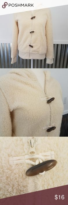 "Ruff Hewn Fuzzy Hoodie Jacket with Toggle Buttons Ruff Hewn Fuzzy Cream Hoodie Jacket with Toggle Buttons in good condition. This jacket definitely shows signs up wear but still has lots of life left. It zips and buttons and has a hood. It is 100% Polyester. Machine wash cold. Approximate measurements are: 19"" Chest, 24"" Long (back collar to bottom) Ruff Hewn Jackets & Coats"