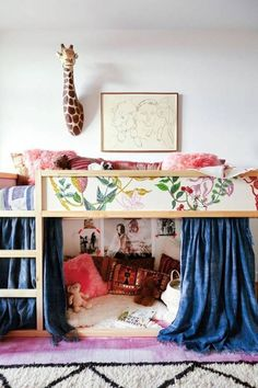 kura bed covered with scraps of floral wallpaper and with a cozy reading nook on the floor - DigsDigs