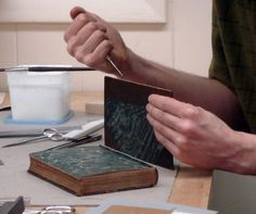 Christopher Clarkson developed a method of reattaching book boards in which a slot is cut into the board to accept a flange of textile that is attached to the spine of the textblock
