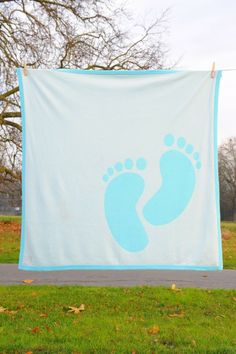 Angel Cashmere - Cashmere/Silk Blue 'Baby Feet' Reversible Baby Blanket (Large), �85.00 (http://www.angelcashmere.com/cashmere-silk-blue-baby-feet-reversible-baby-blanket-large/)