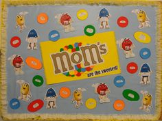 May bulletin board using M&M's as the theme for Mother's Day.  Birthdays are listed on the M&M's and the anniversaries are on are on the M&M characters.