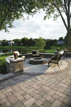 Unilock Pavers: Brussels Block Patio with Olde Quarry seat walls and fire pit