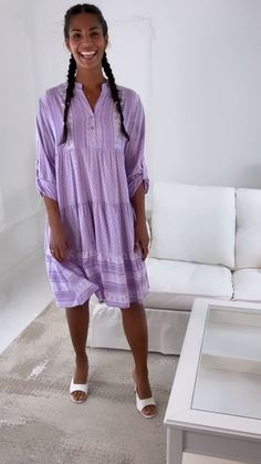 Smock Dress Mini dress Stand up collar with V neck Long sleeves with roll-up tab features Button up from the waist up Tiered mini skirt Relaxed fit Dress Stand, Smock Dress, Occasion Wear, Smocking, Lavender, Mini Skirts, V Neck, Button, Long Sleeve