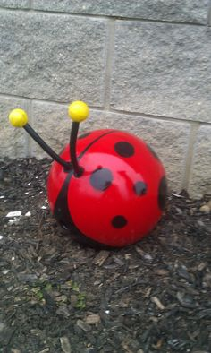 My version of the Ladybug Bowling ball I saw in Birds and Blooms magazine.    http://www.birdsandblooms.com/Backyard-Projects/Garden-Crafts/Bowling-Ball-Bugs