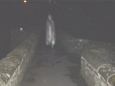 """An old stone bridge called Packhorse Bridge in the northeastern Welsh village of Caergwrle is the scene of this ghostly photograph. Locals say this is the ghost of """"Squire Yonge"""". However, this term turns up in Chaucer as well as Arthurian literature, and means young squire, which could refer to any number of people. The bridge was built in the 17th century. Nearby Caergwrle Castle was mostly completed by 1282, the final castle built before Wales lost its independent to England."""
