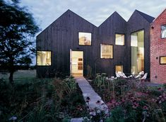 """This house extension is clad in charred cedar, creating a """"shadow-like"""" effect"""