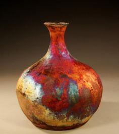 Rake bottle   www.potterybynitaclaise.com.  FB: Pottery by Nita Claise