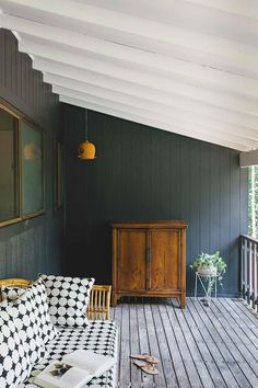 Verandah of a renovated cottage in Byron Bay. The weatherboard exterior has been painted Dulux Domino | Photography: Marnie Hawson | Styling: Sabine Pick