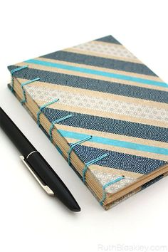 This little handmade journal is the perfect gift for a writer - blue striped handmade book by Ruth Bleakley