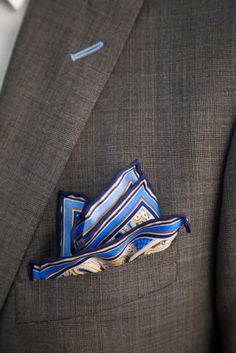 Your pocket square should always compliment a color in your tie or suit. www.enzocustom.com