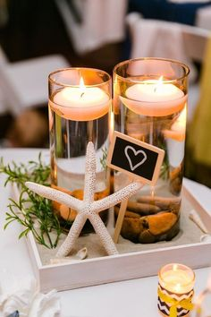 For an easy DIY wedding centerpiece, create this beach in a box to beautify your tables on a budget.